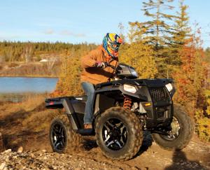 2016.polaris.sportsman570sp.black.front-right.riding.on-trail.jpg