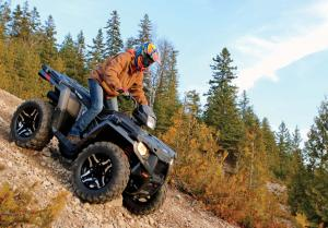 2016.polaris.sportsman570sp.black.right.riding.on-rocks.jpg