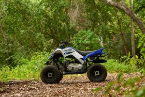 2016.yamaha.raptor90.blue_.left_.parked.in-woods.jpg