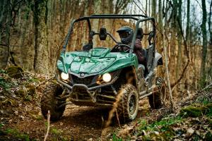 2016.yamaha.wolverine.green_.front-left.riding.on-path.jpg