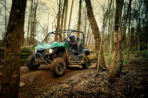 2016.yamaha.wolverine.green_.front-left.riding.through-woods.jpg