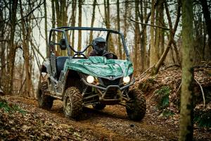 2016.yamaha.wolverine.green_.front-right.riding.on-path.jpg