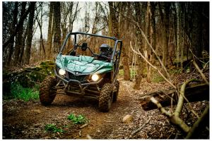 2016.yamaha.wolverine.green_.front_.riding.through-woods.jpg