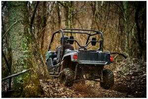 2016.yamaha.wolverine.green_.rear-left.riding.in-woods.jpg