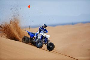 2016.yamaha.yfz450.blue.front-right.riding.on-sand-dune.jpg