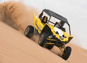 2016.yamaha.yxz1000r.yellow.front-right.riding.on-sand.jpg
