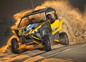 2016.yamaha.yxz1000r.yellow.front.riding.on-sand.jpg