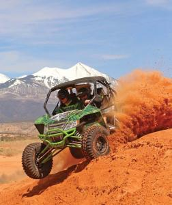 2017.arctic-cat.wildcat-sport.black-and-green.front-left.riding.on-sand.jpg