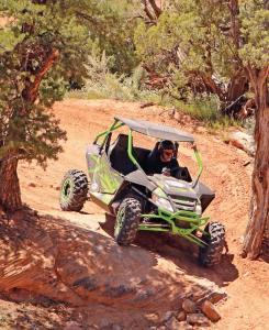 2017.arctic-cat.wildcat-sport.black-and-green.front-right.riding.down-rocks.jpg