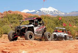 2017.arctic-cat.wildcat-sport.white.front-left.riding.over-rocks.jpg