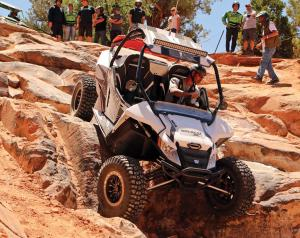 2017.arctic-cat.wildcat-sport.white.front.riding.down-rocks.jpg