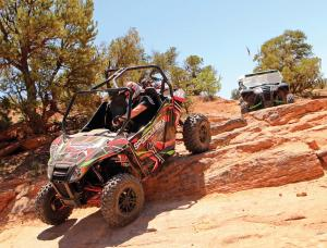 2017.arctic-cat.wildcat-trail.red.front-left.riding.down-rocks.jpg