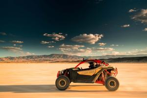 2017.can-am.maverick-x3-xrs-turbo-r.gold.left.riding.on-sand.jpg