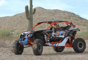 2017.can-am.maverick-x3daytona-package.black.front-left.parked.on-sand.jpg