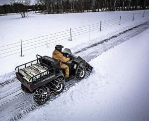 2017.feature.snow-plow-review.atv-plowing-snow.jpg