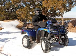 2017.feature.winter-tech-tips.handlebar-boots.on-atv.riding.in-snow.jpg