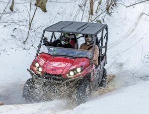 2017.feature.winter-tech-tips.side-x-side.riding.through-snow.jpg