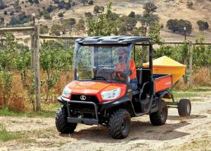 2017.kubota.orange.front-left.hauling-spreader.on-farm.jpg