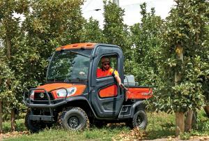 2017.kubota.orange.left.riding.between-trees.jpg