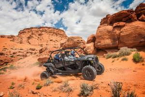 2017.polaris.rzr-xp-turbo4-eps.grey_.right_.riding.on-sand.jpg