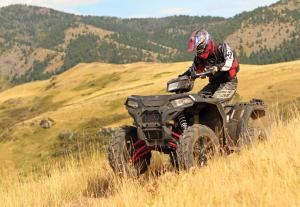 2017.polaris.sportsman-xp1000.green_.front-left.riding.in-field.jpg