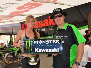 atvillustrateds.cory-weller.holding-kawasaki-monster-energy-sign.jpg