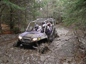 location.2011.moran-michigan.polaris-rzr.riding.through-mud.jpg
