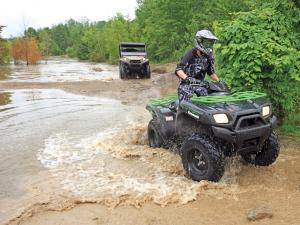 location.2012.anthracite-outdoor-adventure-area.kawasaki-brute-force.riding.through-water.jpg