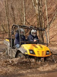 location.2012.hatfield-mccoy.west-virginia.cubcadet-volunteer.riding.through-mud.jpg