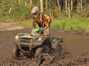 location.2012.hatfield-mccoy.west-virginia.kawasaki-brute-force.green.front-left.riding.through-mud.jpg