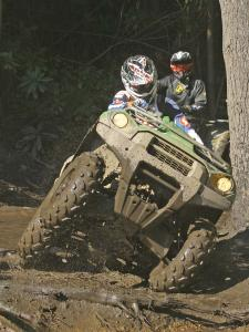 location.2012.hatfield-mccoy.west-virginia.kawasaki-brute-force.green.front.riding.through-mud.jpg