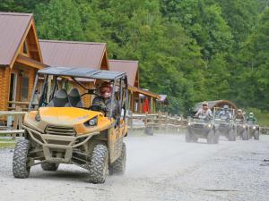 location.2012.hatfield-mccoy.west-virginia.kawasaki-teryx.yellow.riding.on-dirt-road.jpg