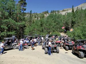 location.2012.high-mountain-atv.jamboree.wallace-idaho.group-of-side-x-sides-and-atvs.parked.jpg