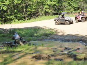 location.2012.mines-and-meadows.atv.riding.through-mud.jpg