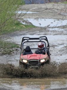 location.2013.harlan-county-kentucky.polaris-rzr.riding.through-mud.JPG