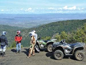 location.2014.eastern-sierra-atv-and-utv-jamboree.atvs.parked.by-cliff.JPG