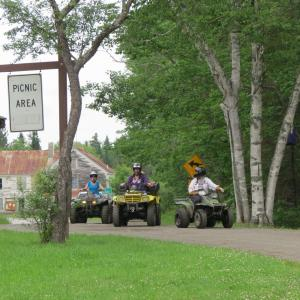 location.2014.north-country-rivers.maine.atvs-riding.on-road.jpg