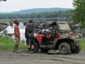 location.2014.north-country-rivers.maine.polaris-rzr.parked.on-road.jpg
