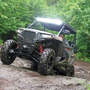 location.2016.north-country-rivers.polaris-rzr.riding.over-rocks.jpg