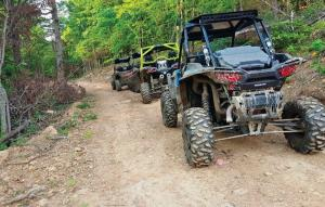 location.2016.rush-off-road-park.side-x-sides-in-line-parked.jpg
