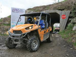 location.hatfield-mccoy.side-x-sides-and-atvs.riding.through-tunnel.jpg