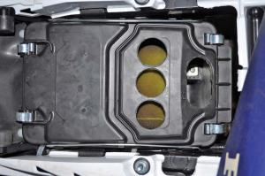 tech-tips.2016.honda.trx450r.airbox-with-holes.close-up.jpg