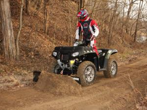 vendor.2010.polaris.atv-plow.front-left.pushing.dirt_.jpg