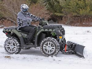 vendor.2010.polaris.atv-plow.right_.plowing.snow_.jpg