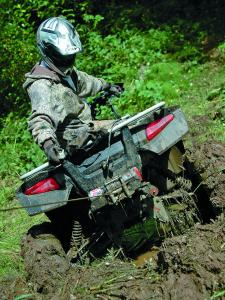 vendor.2010.warn_.xt25-winch.on-atv-rear.pulling-through-mud.jpg