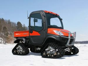 vendor.2011.mattracks.litefoot.utv-track-system.on-kubuta.parked.on-snow.jpg