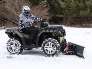 vendor.2011.polaris-glacier.atv-snowplow.in-action.jpg