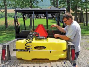 vendor.2012.cabelas-atv-sprayer.on-side-x-side.in-use.jpg