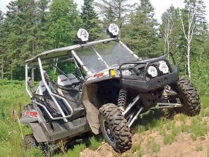vendor.2012.extreme-metal-products.polaris-rzr.front-brush-guard.parked-on-hill.jpg