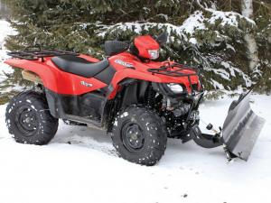 vendor.2013.american-manufactuering.eagle-plow.on-suzuki-kingquad.parked.on-snow.JPG